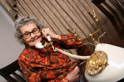 Elderly grandmother receiving her daily call from Keeping In Touch Solutions